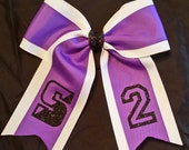 Custom bow with team logo and number
