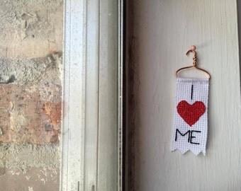 I <3 ME cross stitch mini banner on copper hanger