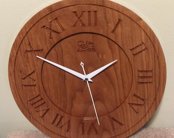 Craft clock engraved in solid cherry wood