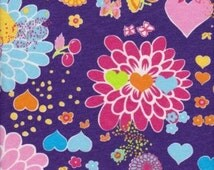 KNIT Fabris: Rainbow Flowers on cotton lycra fabric. Sold by 1/2 yard.
