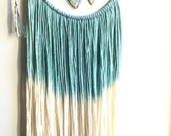 Wall suspension / tie & turquoise dye / feathers in clay