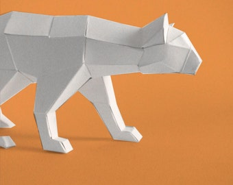 Sculpture in paper Panther at climb
