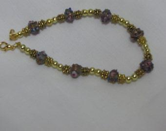 """8"""" goldand purple lampwork beaded bracelet"""
