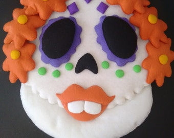 Ornament for door of head of Catrina