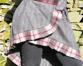 Simple Wraparound woollen skirt, asymmetric hem, tartan trim, woollen fabric. All sizes