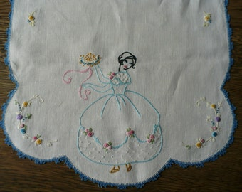 "Vintage handmade linen table runner or dresser cloth with embroidered woman and flowers and scalloped crocheted, 34"" x 17"" blue edge"