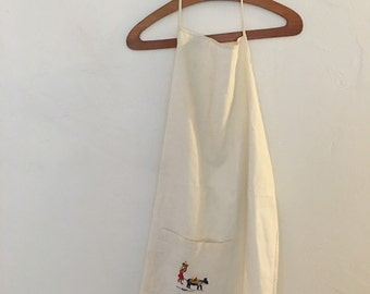 Embroidered ivory apron
