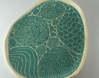 Asymmetrical carved turquoise plate