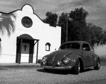 black and white Photograph of green Volkswagen Beetle in front of old church, VW bug, old car, classic car, Volkswagen, vintage cars, church