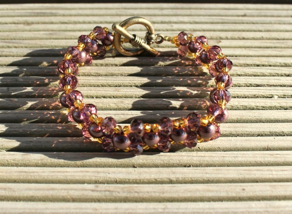 Handmade bracelets with glass beads and purple pearls