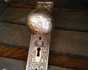Antique Brass  doorknob, door plate, and rosette