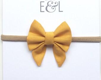 Tiny sailor bow