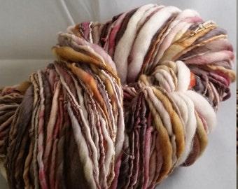 Bird's Nest colourway, thick and thin, single ply, handspun, textured, art yarn, overspun, merino, 140m (153yds), 100% wool, 112 gms (4oz).