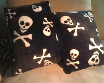 Skull and crossbones cushion