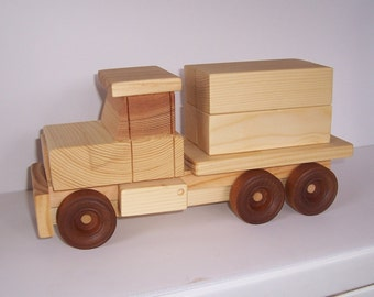 Handmade wooden toy lumber truck.