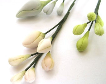 Assorted small buds - gum paste filler flowers , sugar paste cake toppers, cake decoration