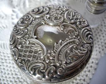 Antique vanity jar with repousse lid.