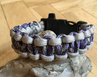Paracord bracelet with whistle and firestarter