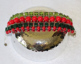 Bracelet of red and green beads.