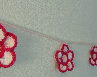 Crocheted pink flowers garland