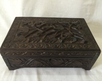 Old wooden carved storage box