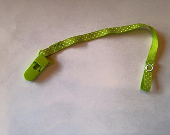 Pacifier clip, green ribbon with white dots.