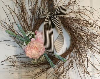 Wreath/pink flowers/black cream ribbon