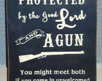 This house is protected by the good Lord and a gun.