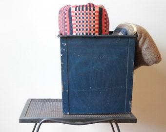 Vintage industrial blue folded metal storage bin or waste paper basket