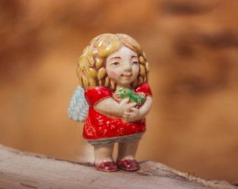 little ceramic doll