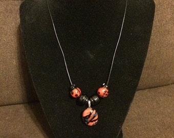 Rocking red dichroic pendant