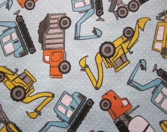 Diggers and Trucks on pale blue brushed cotton with little white polka dots - 115cm wide with free 2nd class post sold per fat quarter