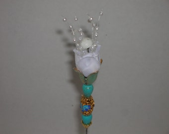 You may not see it at first but this is a real Vintage hatpin