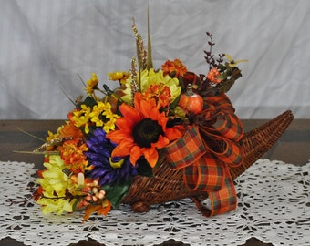 smaller cornucopia basket, fall table arrangement, orange and yellow arrangement, Thanksgiving arrangement, fall decor, pumpkin basket