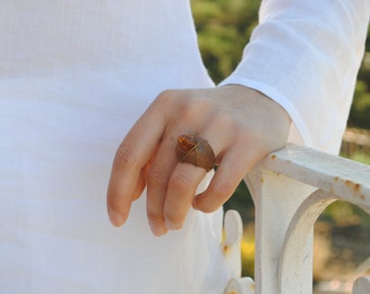 Wooden ring with amber