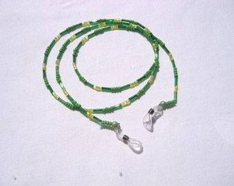Necklace of green beads and Bugle beads made of glass with colorless elastic loops