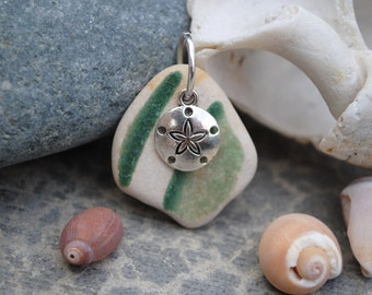 Tumbled pottery with sand dollar charm
