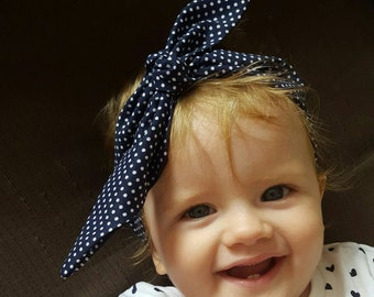 Navy blue and white dots tied baby headband. Fits 1-3 years