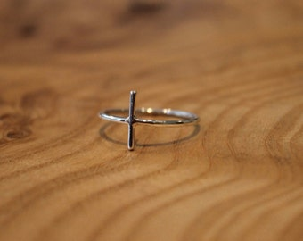 92.5% Sterling silver cross ring. Very delicate.