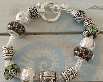 Green/black charm bracelet