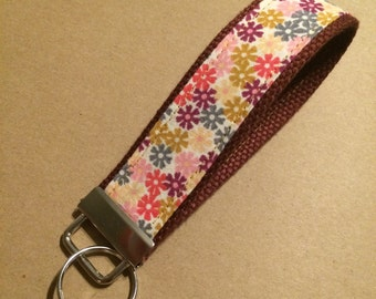 Funky floral fabric on maroon webbing key fob or zipper pull