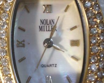 BEAUTIFUL!!! 8 inch gold toned NOLAN MILLER watch