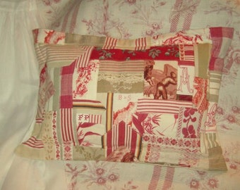 Cushion made with old fabrics, lace and stripes, red dominance