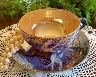 Hand painted tea cup and saucer.