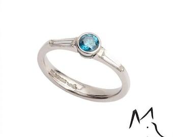 Platinum and Blue Diamond Engagement Ring