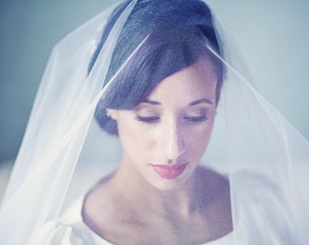 Scalloped edged crystal or pearl bridal veil