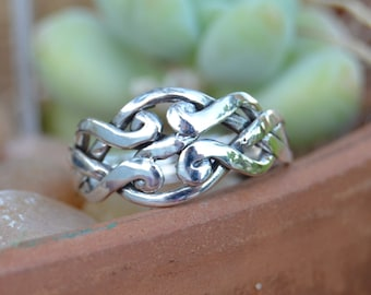 4 piece Sterling Silver Puzzle Ring in sizes 6, 8