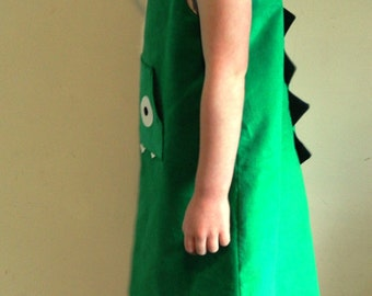 Cute Little Green Dinosaur Girls Dress with Scary Teeth and Spikes on Back