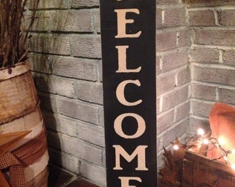 Primitive wooden distressed welcome sign