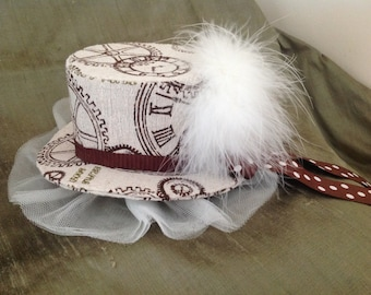 Steampunk mini top hat, in Ivory and brown Clock pattern fabric.